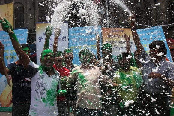 Supporters of Pranab Mukherjee celebrate on Kolkata streets on Sunday