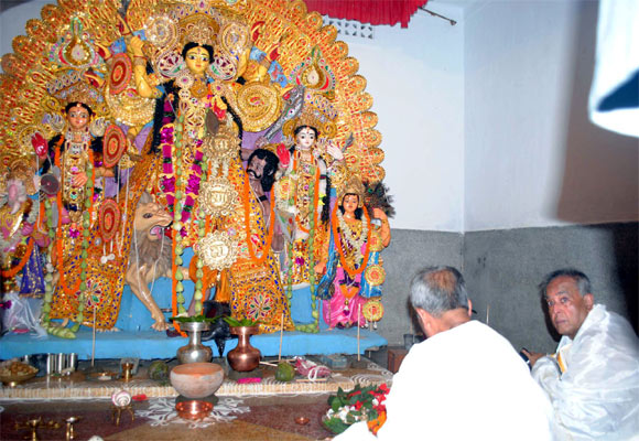 File photo of Pranab taking part in the Durga Puja ceremony at his ancestral village