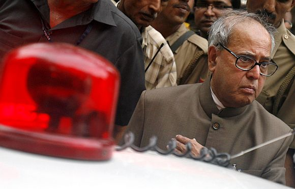 Pranab Mukherjee leaves after a meeting in New Delhi