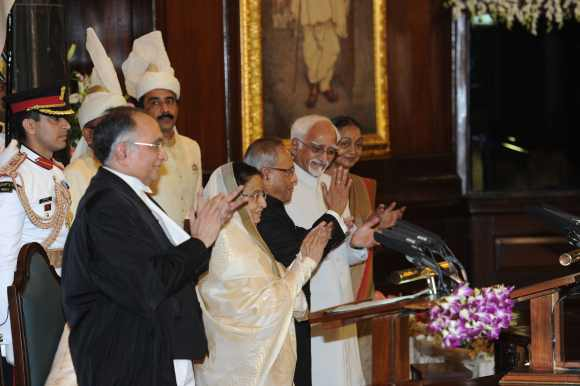 Mukherjee with outgoing President Pratibha Devisingh Patil, Vice President Mohd Hamid Ansari, Speaker Meira Kumar and Chief Justice of India S H Kapadia at the swearing-in ceremony in the Central Hall of Parliament