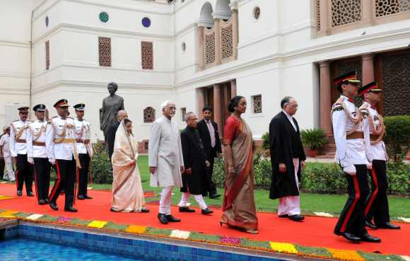 Pratibha Patil, Mukherjee, Ansari and Kapadia in a ceremonial procession at Parliament House for the swearing-in
