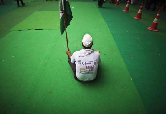 A supporter of veteran Indian social activist Anna Hazare, takes part in a protest in New Delhi July 25