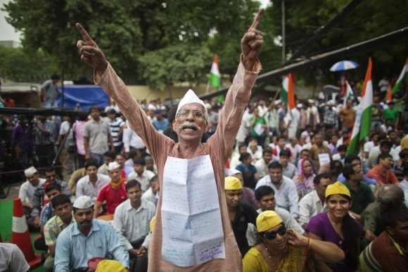 A supporter of Hazare shouts slogans as he takes part in a protest in New Delhi