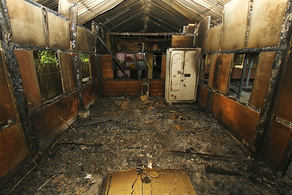 An interior view of a house that was burnt during ethnic riots is seen near Goshaigaon town, in Assam