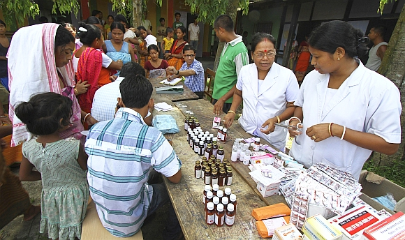 Villagers affected by the ethnic riots, crowd at a relief camp to receive medicines provided by the district administration near Kokrajhar town in Assam