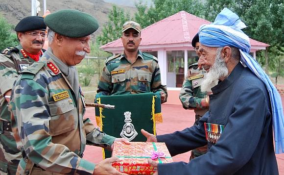 Gen K T Parnaik felicitates a war veteran