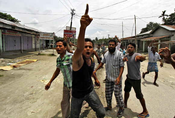 Villagers affected by the ethnic riots demonstrate against the visit of Assam legislators at a relief camp in Bijni town