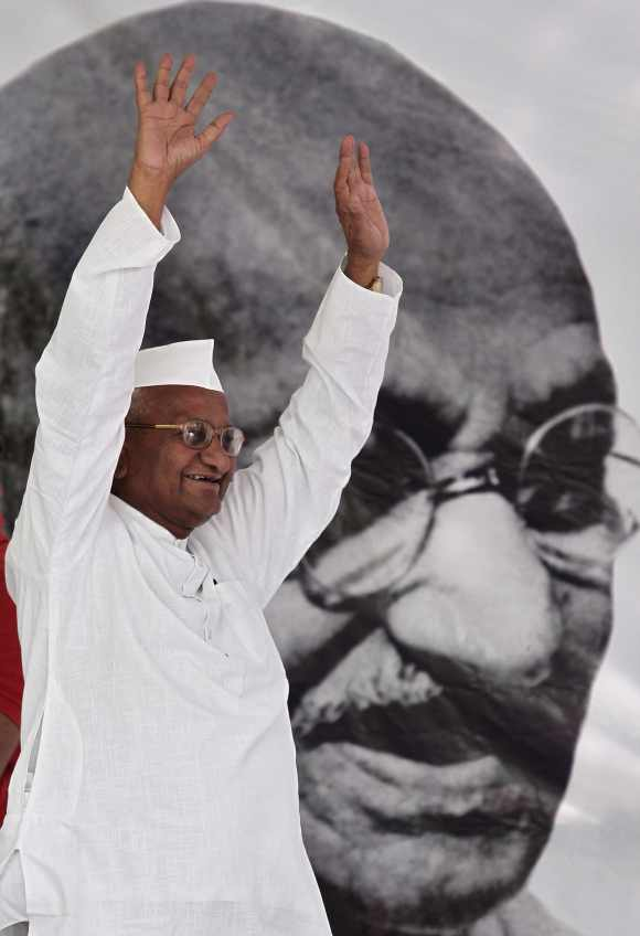 Anna Hazare waves to his supporters in New Delhi