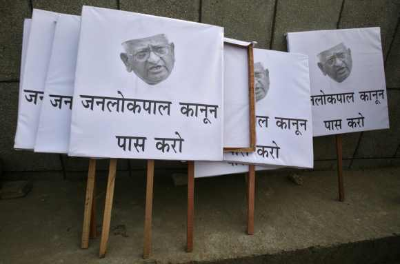 Placards are seen on a sidewalk during a campaign in support of a controversial anti-corruption bill in New Delhi