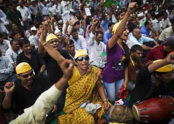 Supporters of Hazare shout slogans as they take part in a protest in New Delhi July 25