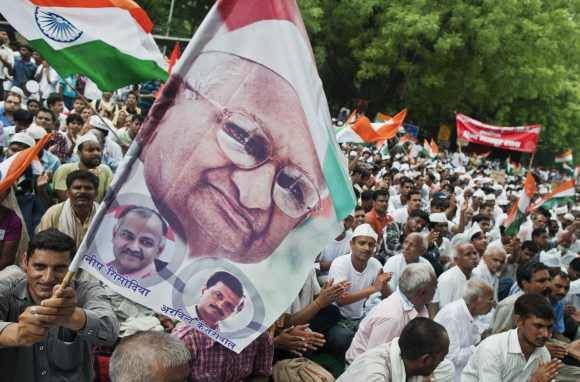 A Hazare supporter A supporter waves a flag during a protest in New Delhi July 25