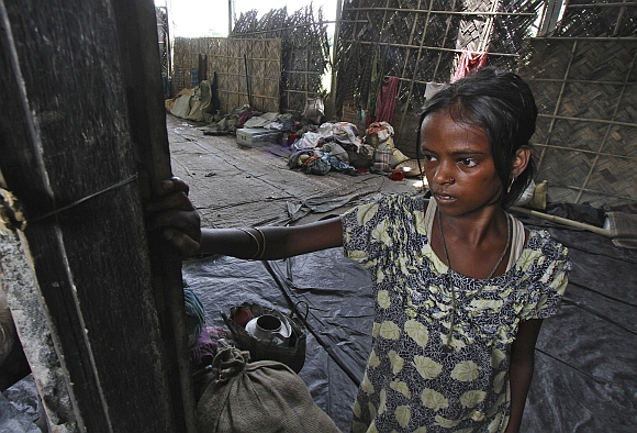 A girl affected by ethnic riots is seen inside a relief camp near Bijni in Assam