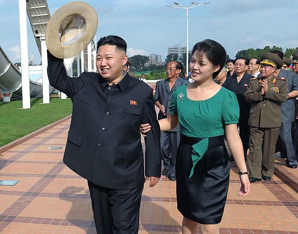 North Korean leader Kim Jong-Un and his wife Ri Sol-Ju attend the opening ceremony of the Rungna People's Pleasure Ground on Rungna Islet along the Taedong River in Pyongyang in this July 25, 2012 photograph released by the North's KCNA to Reuters