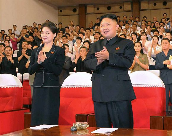 North Korean leader Kim Jong-Un applauds with his wife Ri Sol-Ju during a demonstration performance by the newly formed Moranbong band in Pyongyang
