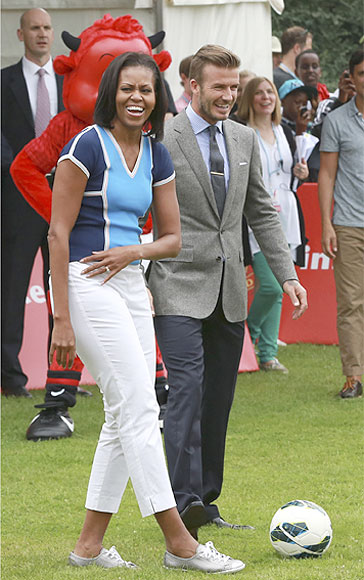 Michelle Obama plays tug of war, football in London