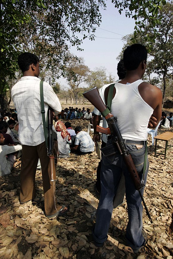 Tribal members of the Salwa Judum movement, a self-defense force of villagers organised to challenge Maoists, gather in Gudma village, about 450km south of Raipur