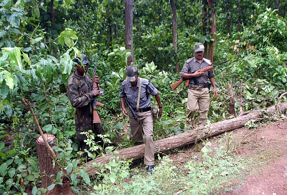 Paramilitary police forces check the blast area inside a forest at Lalgarh, about 200km west of Kolkata