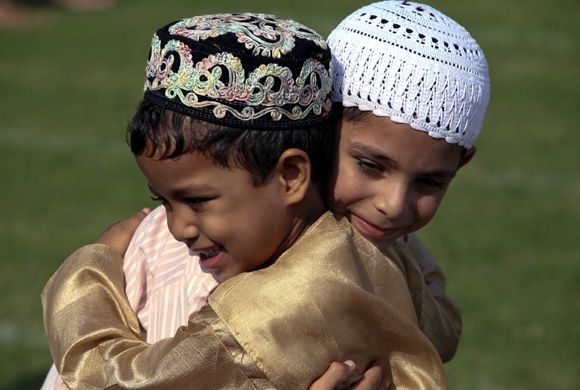 Muslim boys greet each other in Jammu