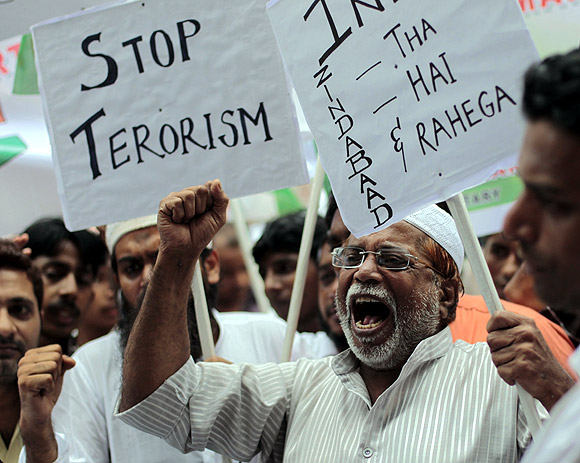 Protestors take part in a rally against terrorism in Mumbai