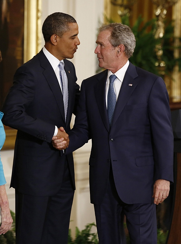 US President Barack Obama shakes hands with former US President George W Bush after Bush's official White House portrait was unveiled during a ceremony in the East Room of the White House in Washington