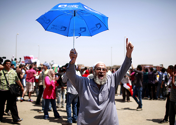 An Egyptian man celebrates after the verdict on Mubarak