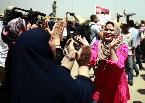 Egyptians celebrate outside the police academy where Mubarak was on trial