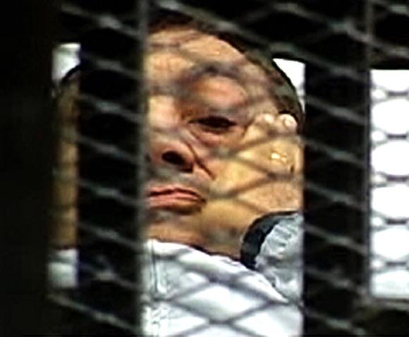 Former Egyptian President Hosni Mubarak is seen in the courtroom for his trial