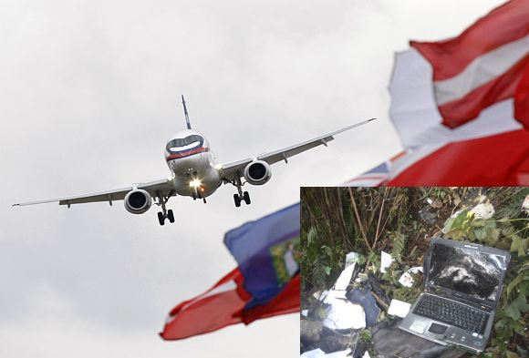 File photo of a Sukhoi Superjet 100. (Inset) Debris and belongings of passengers of the Russian Sukhoi aircraft that crashed on the slopes of Mount Salak are seen at the wreckage site, near Bogor May 11