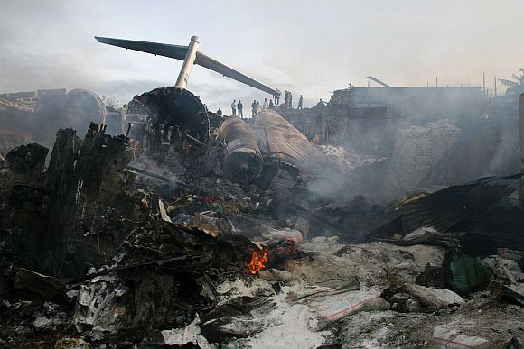 The wreckage of the Hewa Bora Airways passenger jet burns at the crash site in Goma, capital of Democratic Republic of Congo's eastern North Kivu province, April 16, 2008