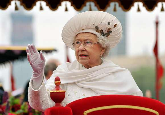 Britain's Queen Elizabeth waves from the Spirit of Chartwell during the Diamond Jubilee River Pageant on the River Thames, in London on Sunday