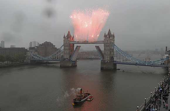 Fireworks go off on Tower Bridge to mark the end of the river pageant in London