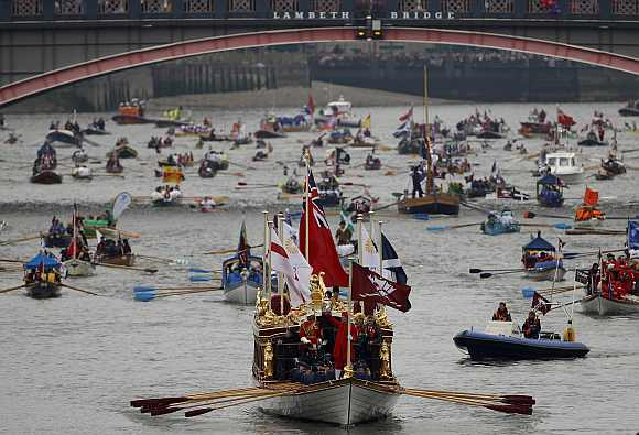 The Gloriana leads the manpowered craft towards Westminster Bridge during Queen Elizabeth