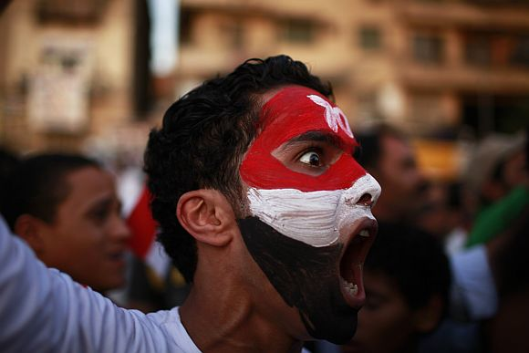A protester shouts during a demonstration at Tahrir square in Cairo