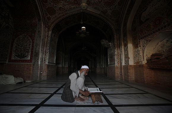 A man reads the Koran at Mahabat Khan mosque in Peshawar