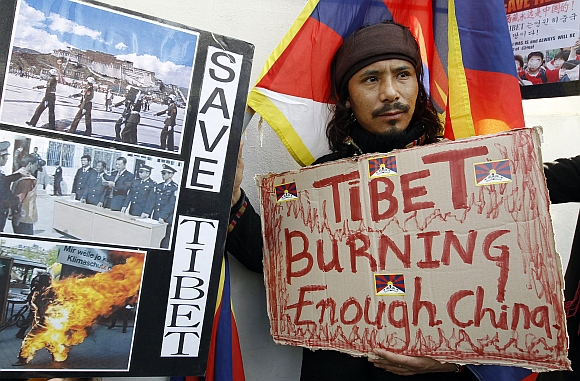 A Tibetan resident takes part in a Free Tibet demonstration denouncing the Chinese government in front of the Chinese embassy in Seoul