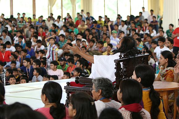 Sri Sri Ravi Shankar interacting with kids
