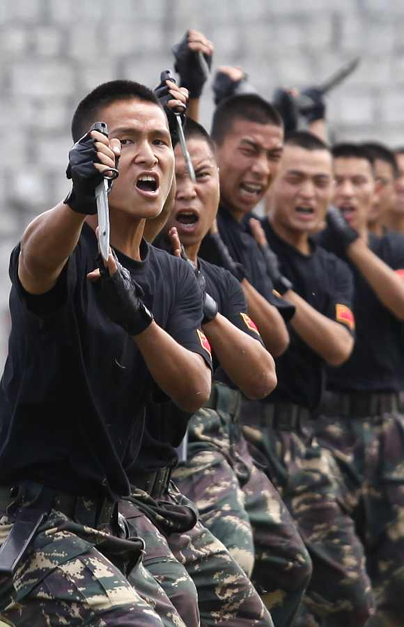 People's Liberation Army soldiers demonstrate their martial arts skills