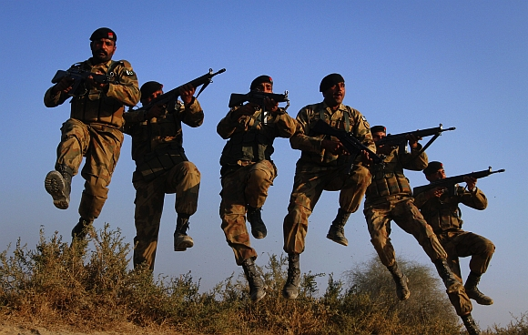 Pakistan Army soldiers take part in winter military exercises in the Cholistan desert, near the Pakistan-India border