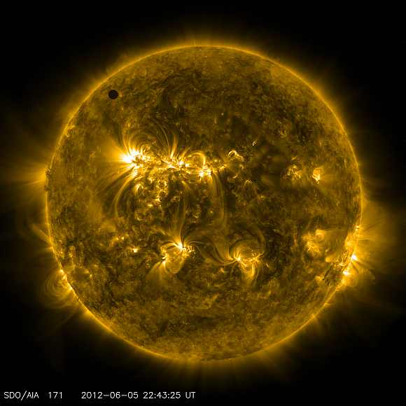 Handout image courtesy of NASA shows the planet Venus transiting the Sun
