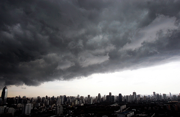 Dark rain clouds hang over Bangkok skyscrapers.The rather strong southwest monsoon prevails over the Andaman Sea and the Gulf of Thailand, which would still bring more rains and flash floods to most parts of the country, weather forecasters say