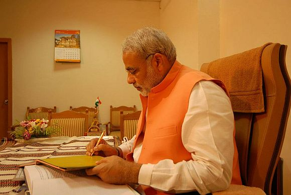 Narendra Modi stands tall as Parivar bows before him
