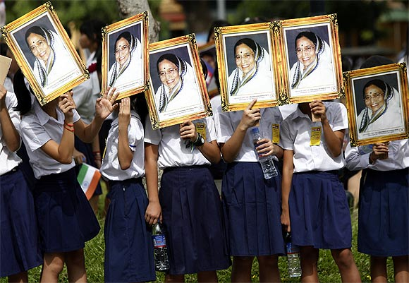 Schoolchildren hold portraits of President Pratibha Patil