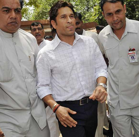 Sachin Tendulkar walks after taking oath at the Parliament in New Delhi