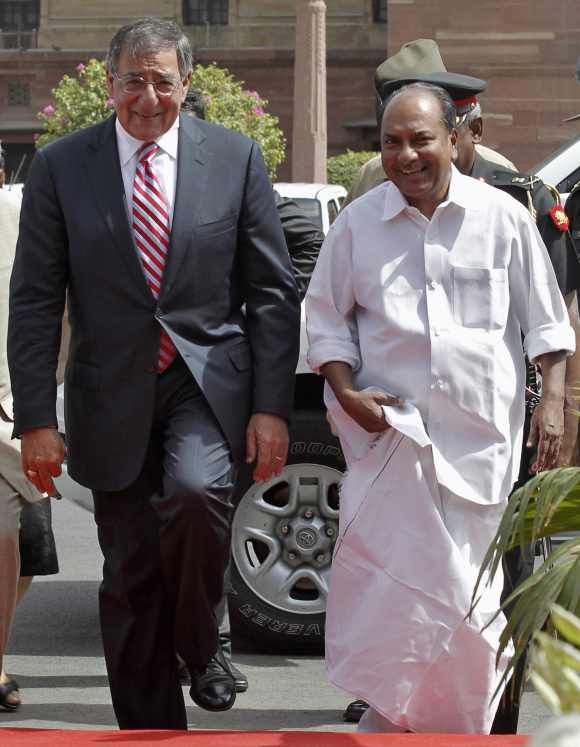 US Defence Secretary Leon Panetta arrives with Defence Minister A K Antony to attend his ceremonial reception in New Delhi June 6