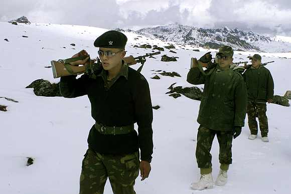 Indian soldiers patrol near the border with China in Tawang, located at a height of 11,000 feet in Arunachal Pradesh