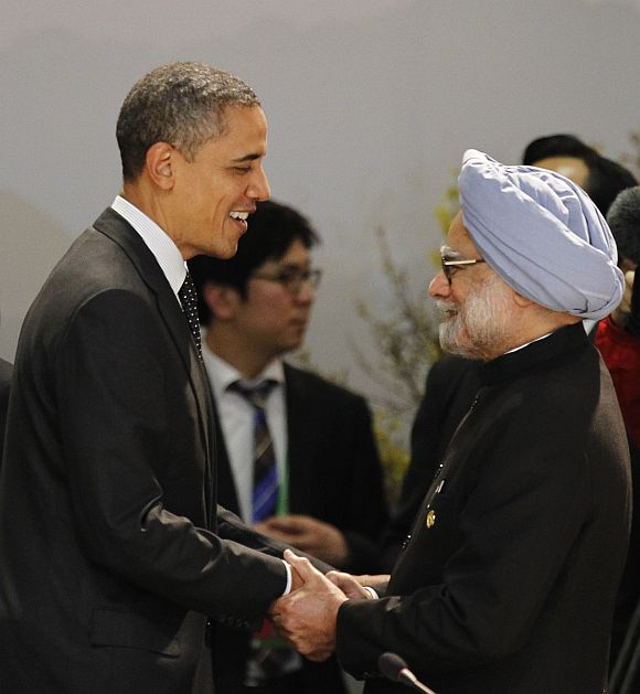 US President Barack Obama shakes hands with Prime Minister Manmohan Singh as they arrive for a working dinner at the Nuclear Security Summit in Seoul