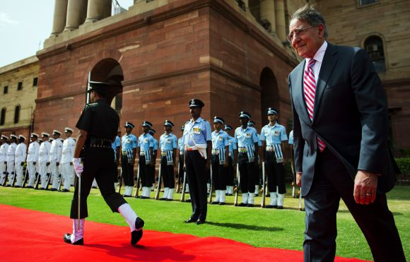 US Defence Secretary Leon Panetta inspects Indian troops during a ceremony in New Delhi on June 6