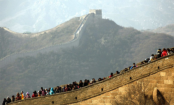 Tourists visit the Badaling section of the Great Wall