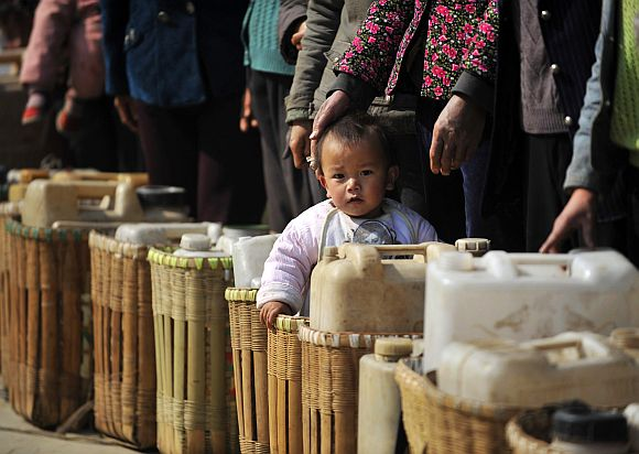 Residents wait to get drinking water distributed by the local government at a drought-hit village in Fuyuan, Yunnan province of China.