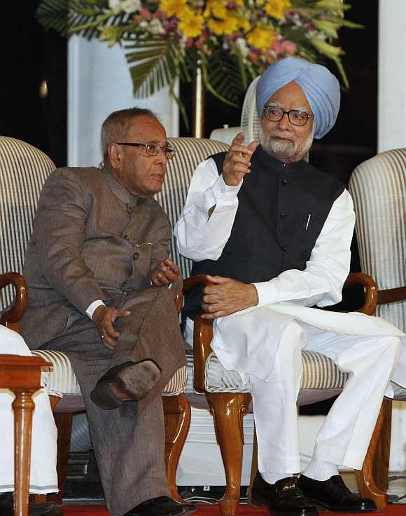 Prime Minister Manmohan Singh with Finance Minister Pranab Mukherjee at a function in New Delhi